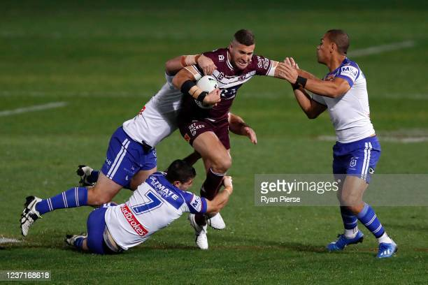 Joel Thompson of the Sea Eagles is tackled during the round three NRL match between the Manly Sea Eagles and the Canterbury Bulldogs at Central Coast...