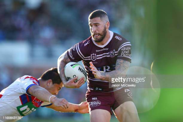 Joel Thompson of the Sea Eagles runs the ball during the round 20 NRL match between the Manly Sea Eagles and the Newcastle Knights at Lottoland on...