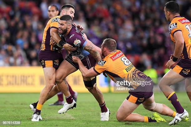 Joel Thompson of the Sea Eagles takes on the defence during the round ten NRL match between the Manly Sea Eagles and the Brisbane Broncos at Suncorp...