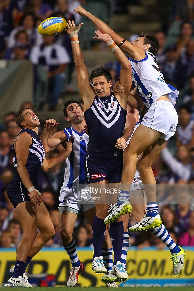 Joel Tippett of the Kangaroos spoils the mark for Matthew Pavlich of the Dockers during the round six AFL match between the Fremantle Dockers and the North Melbourne Kangaroos at Patersons Stadium on April 25, 2014 in Perth, Australia.