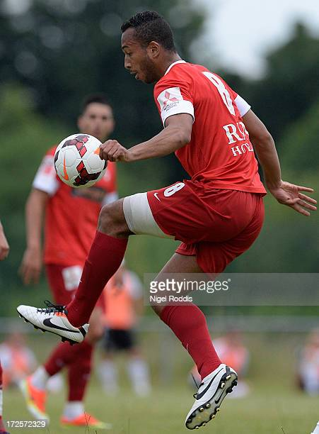 Joel Tomas of Dinamo Bucharest jumps for the ball during a preseason friendly between Livingston and Dinamo Bucharest at the Rothwell Club on July 3...