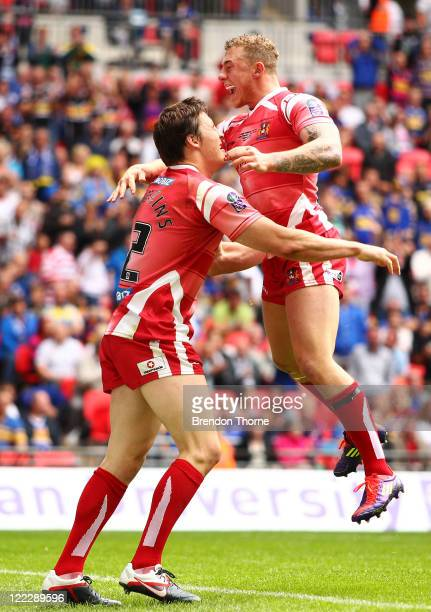 Joel Tomkins of Wigan Warriors celebrates with team mate Lee Mossop after scoring against Leeds Rhinos during the Carnegie Challenge Cup Final...