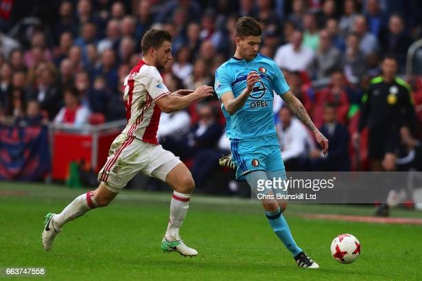 Joel Veltman of AFC Ajax in action with Michiel Kramer of Feyenoord during the Eredivisie match between AFC Ajax and Feyenoord at Amsterdam Arena on...