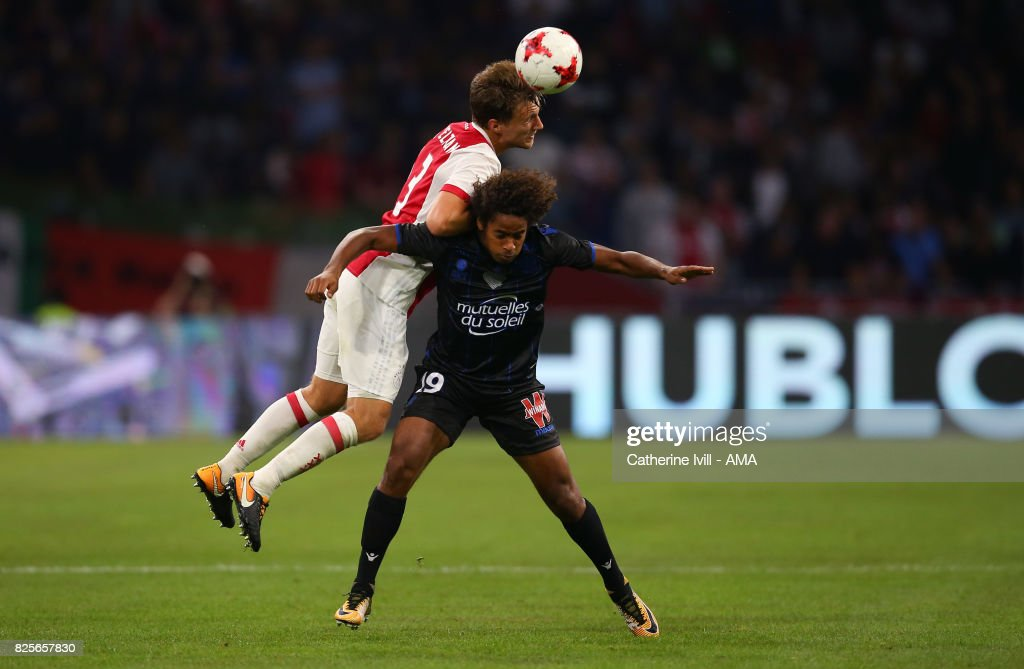 Joel Veltman of Ajax and Vincent Marcel of OGC Nice during the UEFA Champions League Qualifying Third Round match between Ajax and OSC Nice at Amsterdam Arena on August 2, 2017 in Amsterdam, Netherlands.