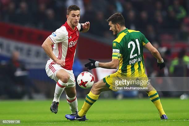 Joel Veltman of Ajax battles for the ball with Edouard Duplan of ADO Den Haag during the Eredivisie match between Ajax Amsterdam and ADO Den Haag...