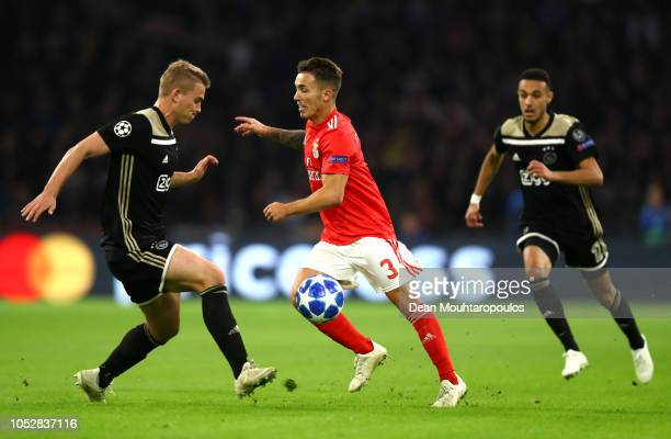 Joel Veltman of Ajax challenges for the ball with Alex Grimaldo of Benfica during the Group E match of the UEFA Champions League between Ajax and SL...
