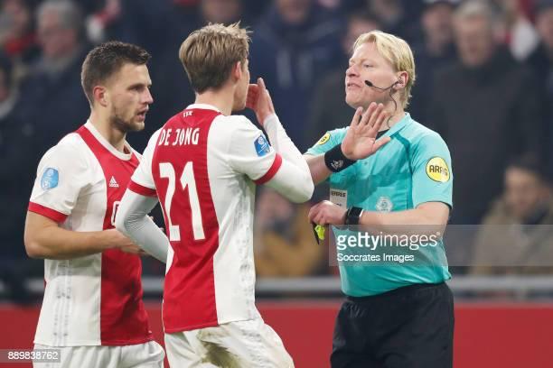 Joel Veltman of Ajax Frenkie de Jong of Ajax referee Kevin Blom during the Dutch Eredivisie match between Ajax v PSV at the Johan Cruijff Arena on...