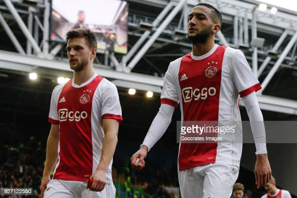 Joel Veltman of Ajax Hakim Ziyech of Ajax disappointed after the game during the Dutch Eredivisie match between Vitesse v Ajax at the GelreDome on...