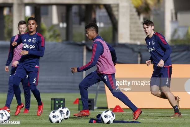 Joel Veltman of Ajax Justin Kluivert of Ajax David Neres of Ajax Maximilian Wober of Ajax during a training session of Ajax Amsterdam at the Cascada...