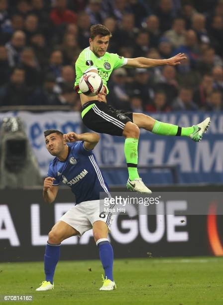 Joel Veltman of Ajax outjumps Sead Kolasinac of FC Schalke 04 cduring the UEFA Europa League quarter final second leg match between FC Schalke 04 and...
