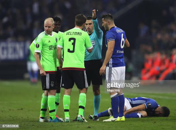 Joel Veltman of Ajax reacts as he is sent off by referee Ovidiu Hategan during the UEFA Europa League quarter final second leg match between FC...
