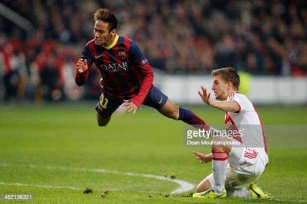 Joel Veltman of Ajax tackles and gives away a penalty on Neymar of Barcelona during the UEFA Champions League Group H match between Ajax Amsterdam...