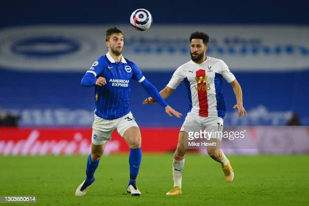Joel Veltman of Brighton & Hove Albion gets away from Andros Townsend of Crystal Palace during the Premier League match between Brighton & Hove...