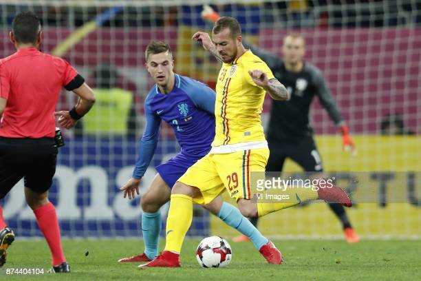 Joel Veltman of Holland Denis Alibec of Romania during the friendly match between Romania and The Netherlands on November 14 2017 at Arena National...