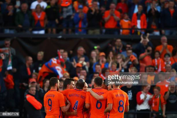 Joel Veltman of the Netherlands celebrates scoring his teams third goal of the game with team mates during the International Friendly match between...