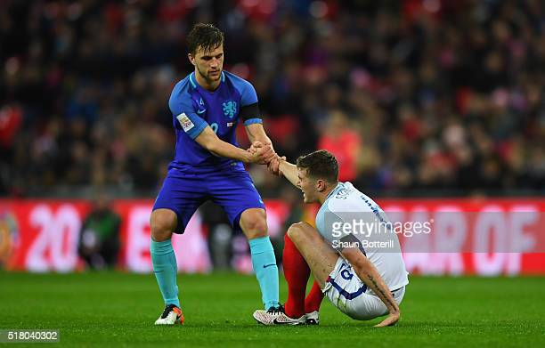 Joel Veltman of the Netherlands helps up John Stones of England during the International Friendly match between England and Netherlands at Wembley...