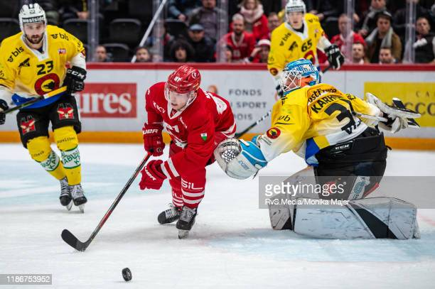 Joel Vermin of Lausanne HC battles for the puck during the Swiss National League game between Lausanne HC and SC Bern at Vaudoise Arena on December...