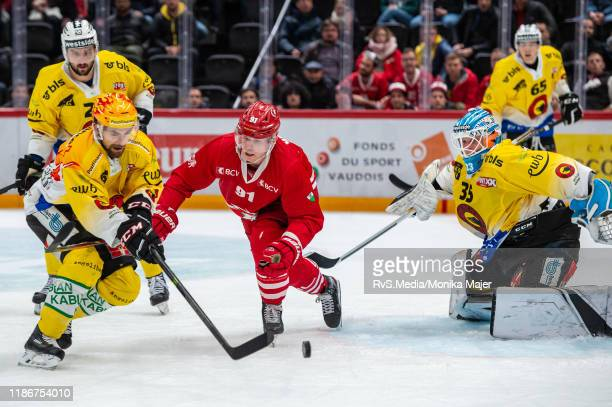 Joel Vermin of Lausanne HC battles for the puck with Mark Arcobello of SC Bern during the Swiss National League game between Lausanne HC and SC Bern...