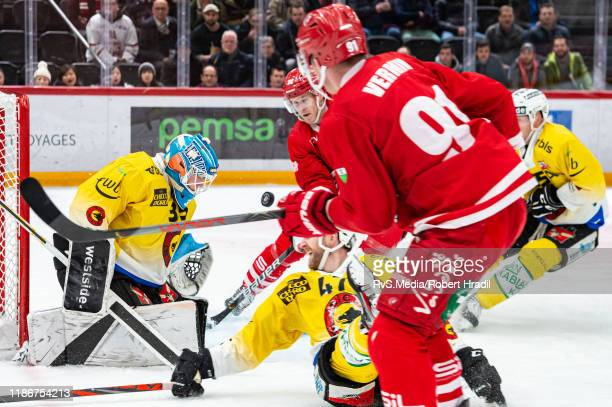 Joel Vermin of Lausanne HC tries to pass a puck on Christoph Bertschy of Lausanne HC during the Swiss National League game between Lausanne HC and SC...
