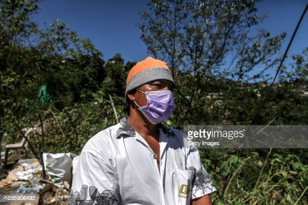 Joel Vicente waits for the body of his nephew William Sigang who is a miner and a victim of the landslide on September 19 2018 in Itogon Benguet...