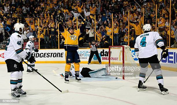 Joel Ward and Brenden Dillon of the San Jose Sharks watch as Colin Wilson of the Nashville Predators holds his hands up in celebration after scoring...