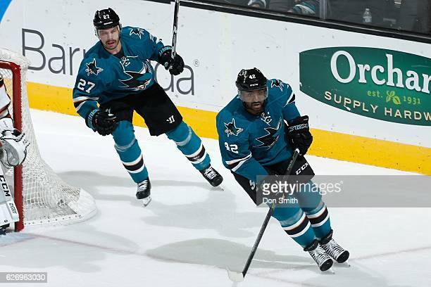 Joel Ward and Joonas Donskoi of the San Jose Sharks look on during a NHL game against the Anaheim Ducks at SAP Center at San Jose on November 26,...
