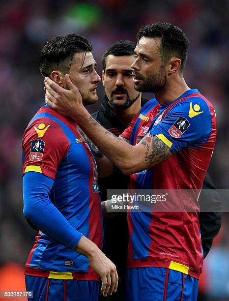 Joel Ward is consoled by team mate Damien Delaney of Crystal Palace as he show his emotions in defeat after The Emirates FA Cup Final match between...