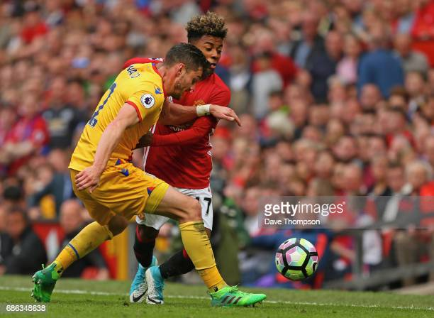 Joel Ward of Crystal Palace and Angel Gomes of Manchester United battle for possession during the Premier League match between Manchester United and...