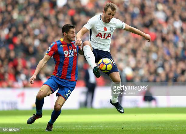 Joel Ward of Crystal Palace and Harry Kane of Tottenham Hotspur battle for possession during the Premier League match between Tottenham Hotspur and...