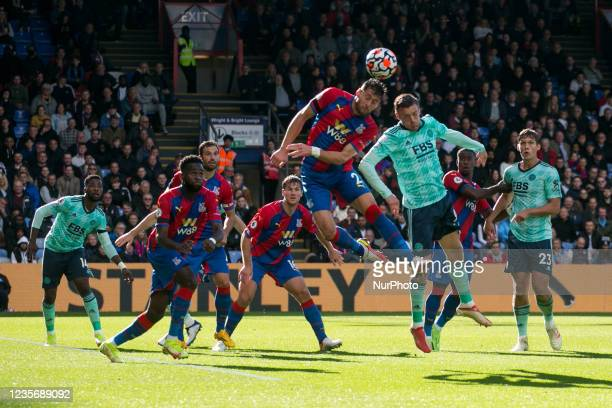 Joel Ward of Crystal Palace and Jamie Vardy of Leicester battle for the ball during the Premier League match between Crystal Palace and Leicester...