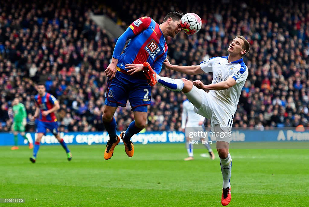 Joel Ward of Crystal Palace and Marc Albrighton of Leicester City compete for the ball during the Barclays Premier League match between Crystal Palace and Leicester City at Selhurst Park on March 19, 2016 in London, United Kingdom.
