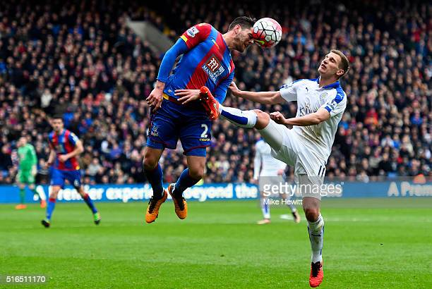 Joel Ward of Crystal Palace and Marc Albrighton of Leicester City compete for the ball during the Barclays Premier League match between Crystal...