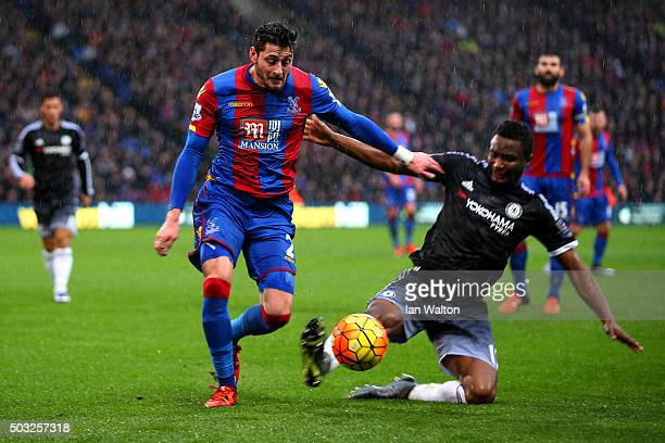 Joel Ward of Crystal Palace battles for the ball with John Obi Mikel of Chelsea during the Barclays Premier League match between Crystal Palace and...
