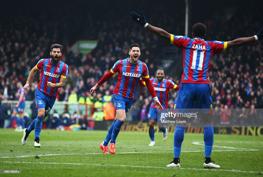 Joel Ward (C) of Crystal Palace celebrates scoring his team's third goal with Joe Ledley (L) and Wilfried Zaha during the Barclays Premier League match between Crystal Palace and Queens Park Rangers at Selhurst Park on March 14, 2015 in London, England.