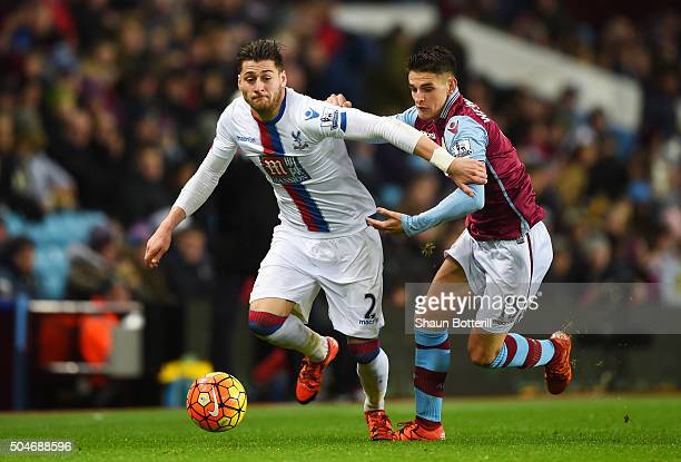 Joel Ward of Crystal Palace holds off Ashley Westwood of Aston Villa during the Barclays Premier League match between Aston Villa and Crystal Palace...