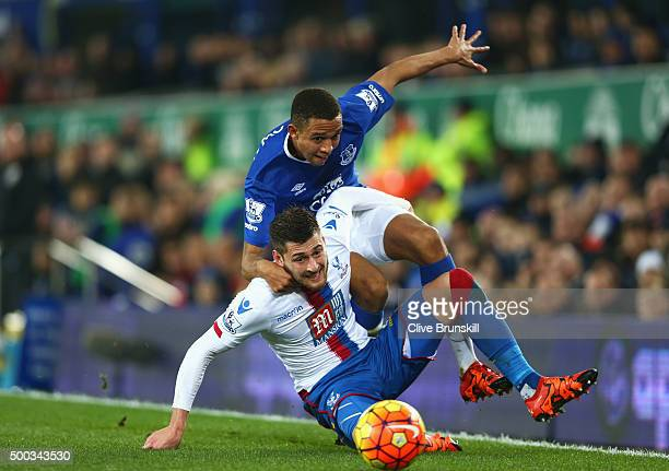 Joel Ward of Crystal Palace is challenged by Brendan Galloway of Everton during the Barclays Premier League match between Everton and Crystal Palace...