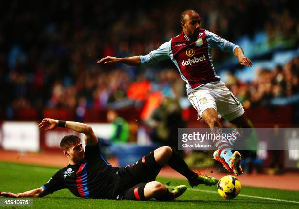 Joel Ward of Crystal Palace tackles Fabian Delph of Aston Villa during the Barclays Premier League match between Aston Villa and Crystal Palace at...