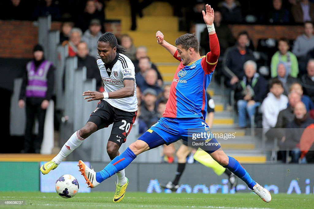 Joel Ward of Crystal Palace tackles Hugo Rodallega of Fulham during the Barclays Premier League match between Fulham and Crystal Palace at Craven Cottage on May 11, 2014 in London, England.