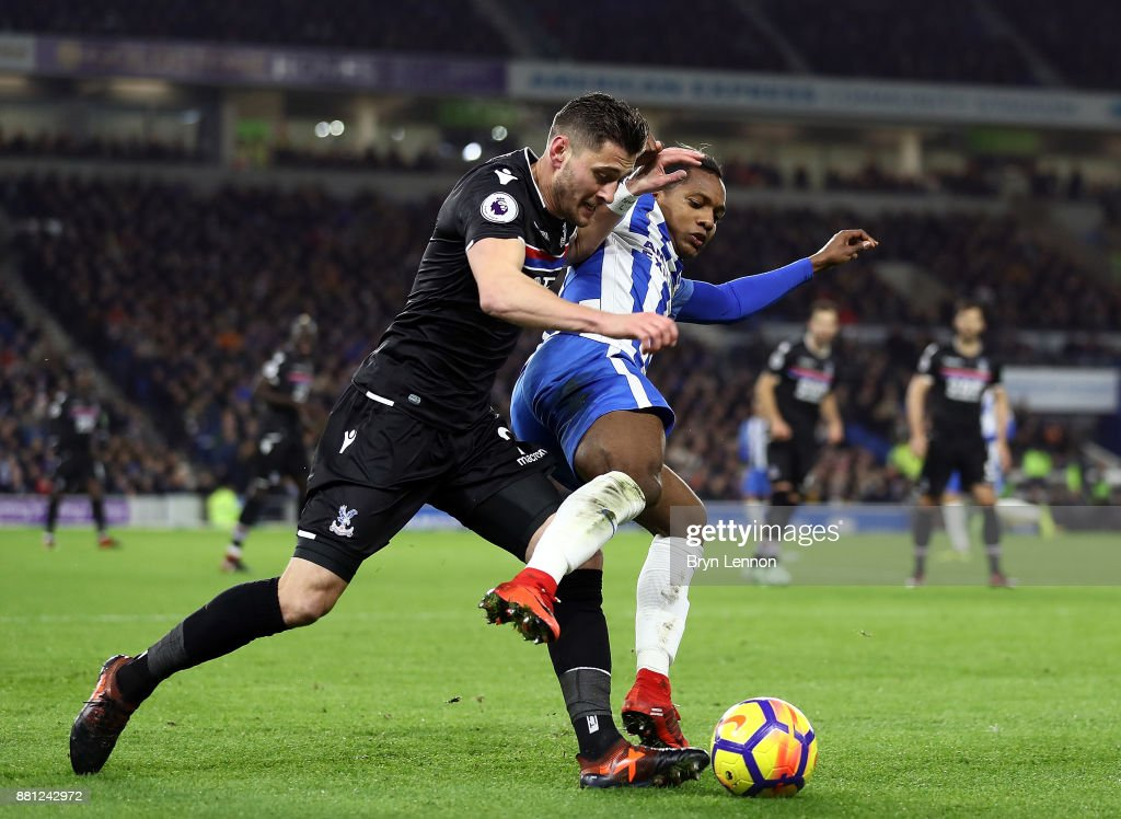 Joel Ward of Crystal Palace tackles Jose Izquierdo of Brighton & Hove Albion during the Premier League match between Brighton and Hove Albion and Crystal Palace at Amex Stadium on November 28, 2017 in Brighton, England.