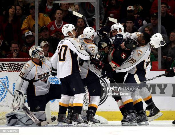 Joel Ward of the Nashville Predators pulls down Troy Brouwer of the Chicago Blackhawks during a 2nd period confrontation in front of the Predator...