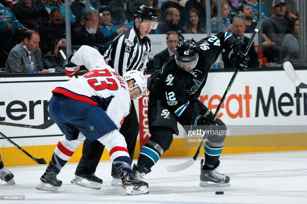 Joel Ward #42 of the San Jose Sharks and Jay Beagle #83 of the Washington Capitals battle for the puck during a face off at SAP Center at San Jose on March 9, 2017 in San Jose, California.