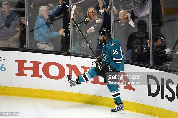 Joel Ward of the San Jose Sharks celebrates after scoring on his second goal on Brian Elliott of the St. Louis Blues in Game Six of the Western...