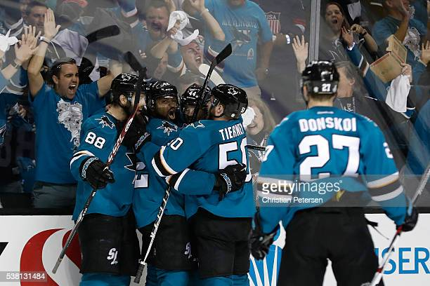 Joel Ward of the San Jose Sharks celebrates his goal with Brent Burns MarcEdouard Vlasic Chris Tierney and Joonas Donskoi against the Pittsburgh...