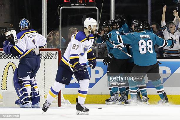 Joel Ward of the San Jose Sharks celebrates his goal with teammates in Game Six of the Western Conference Final against the St. Louis Blues during...