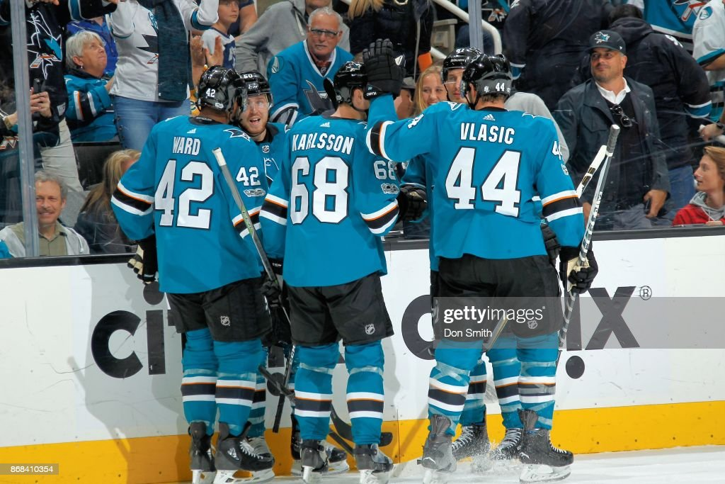 Joel Ward #42 of the San Jose Sharks celebrates his third period goal with teammates during a NHL game against the Toronto Maple Leafs at SAP Center on October 30, 2017 in San Jose, California.