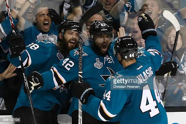 Joel Ward of the San Jose Sharks celebrates with his teammates after scoring a goal against the Pittsburgh Penguins during the third period in Game...