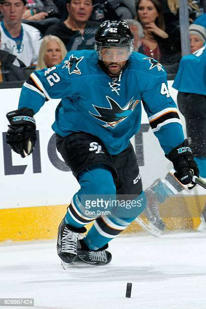 Joel Ward of the San Jose Sharks chases the puck during a NHL game against the Anaheim Ducks at SAP Center at San Jose on November 26, 2016 in San...