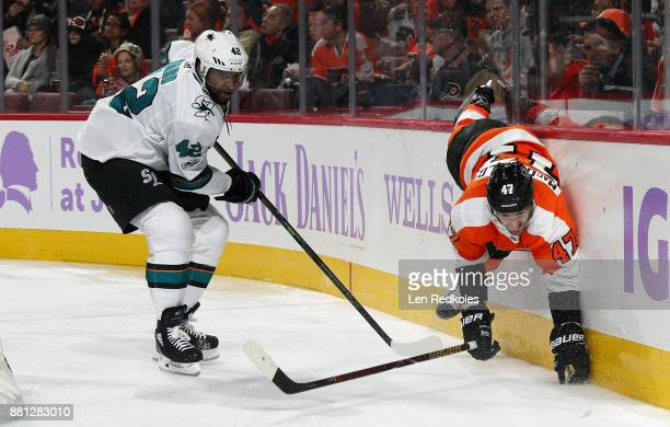 Joel Ward of the San Jose Sharks checks Andrew MacDonald of the Philadelphia Flyers into the boards on November 28 2017 at the Wells Fargo Center in...