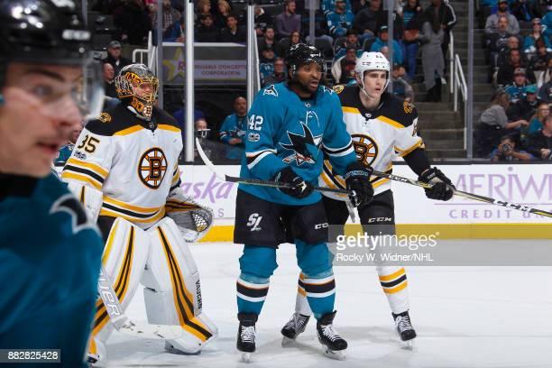 Joel Ward of the San Jose Sharks skates against Anton Khudobin and Rob O'Gara of the Boston Bruins at SAP Center on November 18 2017 in San Jose...
