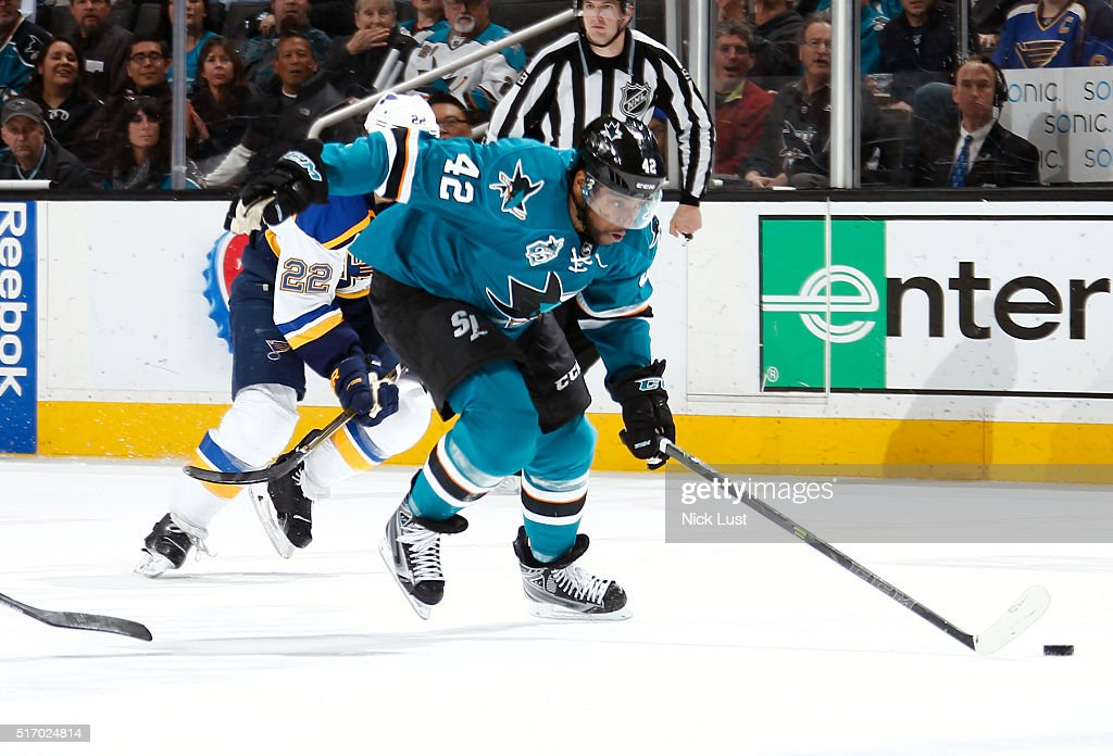 Joel Ward #42 of the San Jose Sharks steals the puck against Kevin Shattenkirk #22 of the St. Louis Blues during a NHL game at the SAP Center at San Jose on March 22, 2016 in San Jose, California.